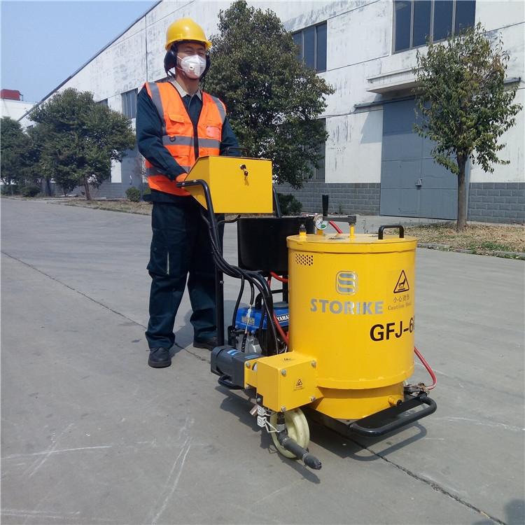 60升沥青灌缝机工作进程操作指南